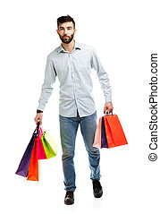Man holding shopping bags. Christmas and holidays concept