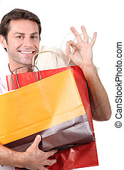 Man holding shopping bags