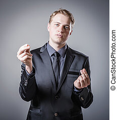 man holding something imaginary in his hands