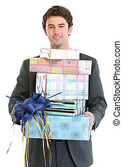 Man holding stack of gift boxes
