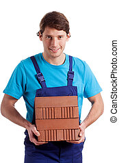 Man holding the bricks - Strong man holding a stack of...