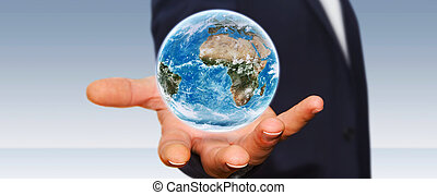 Man holding the planet earth in his hand