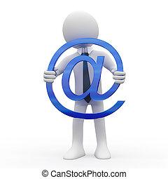 Man holding the @ symbol