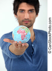Man holding the world in the palm of his hand