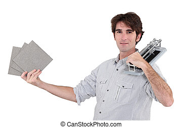 Man holding tile cutting tool