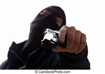 Man holding trigger - A masked man aiming his gun holding...