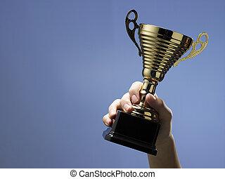 man holding trophy