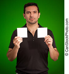 Man holding two blank cards