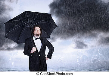 Unhappy Man Holding Umbrella in a Rain Storm and Frowning