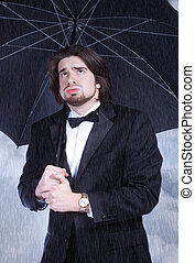 Man Holding Umbrella in the Rain and Sighing