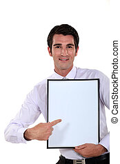 Man holding up a blank bulletin board