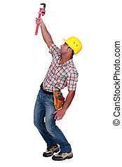 Man holding up adjustable spanner