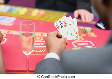 Man holding up poker hand