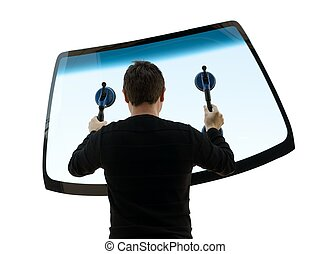 man holding up the windshield over white