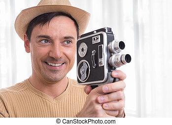 man holding vintage video camera