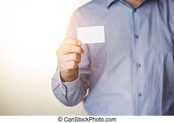 Man holding white business card