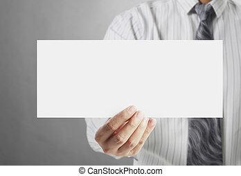 holding white sign