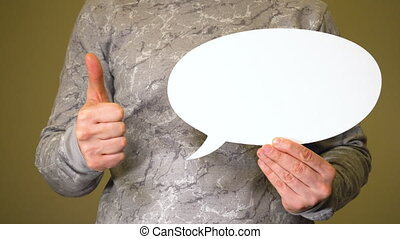 Man holding white talk cloud and show thumbs up