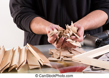 Man holding workpieces of framework