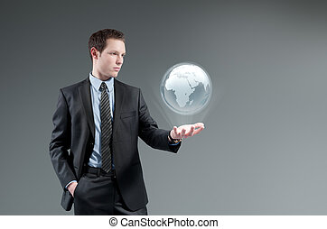 Futuristic technology concept. - Man holding world globe...