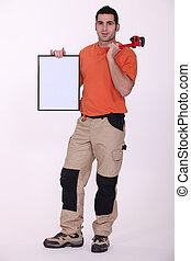Man holding wrench and poster