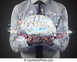 Man holds a brain with business drawing sketches on his ...