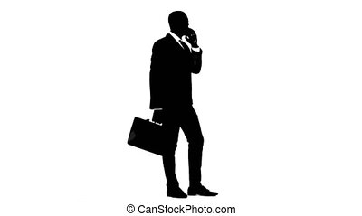 Man holds a briefcase and speaks on the phone. White background. Silhouette