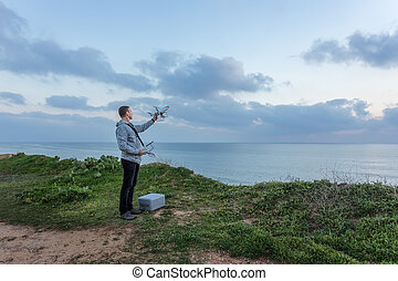 Man holds a drone before the flight.