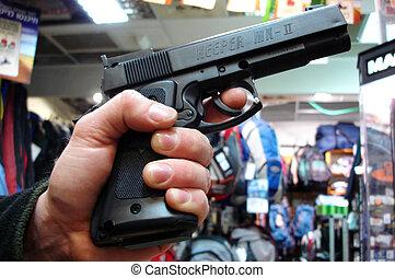 Man holds a gun - TEL AVIV - MAR 28: Man holds a gun on Mar...