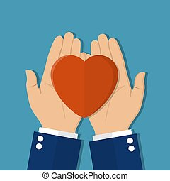 Man holds a heart in his hands.