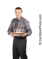 Man holds a pie with burning candles