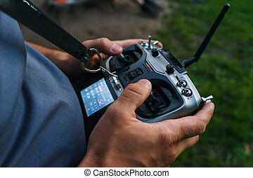 man holds a remote control during the flight control of a sports drones
