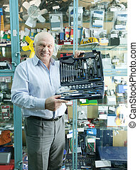man holds automotive tool set in auto parts store