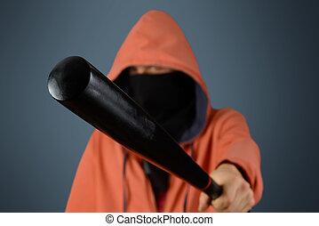 Man holds baseball bat