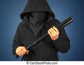 Man holds bat