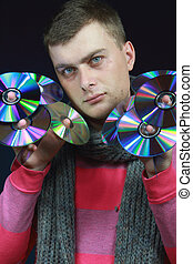 man holds disks in both hands