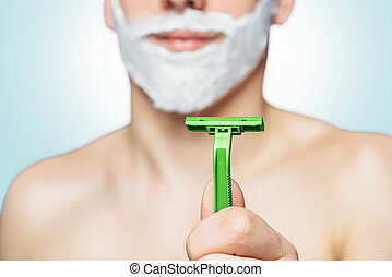 Man holds green razor