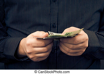 man holds hands Polish money