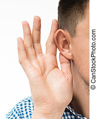 man holds his hand near his ear and listening something
