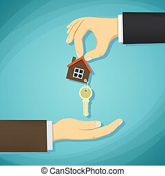 Man holds in his hand the keys to the house. Deal with real esta