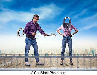 Man holds key, woman with keyhole instead of head
