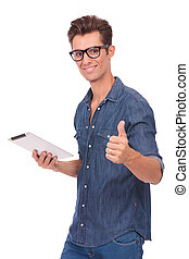 man holds tablet & shows thumb up