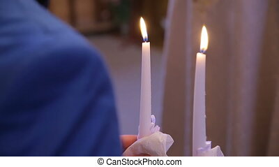 man holds two candles