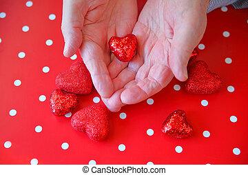 Man holds Valentine glitter heart