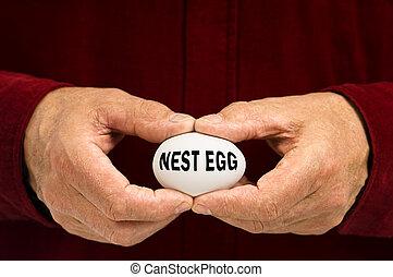 Man holds white egg with NEST EGG written on it