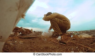 man homeless dump in a landfill homeless looking for food ...