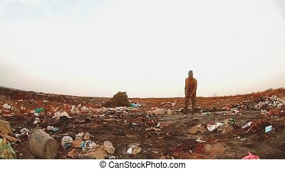 man homeless in a landfill homeless looking for food among ...