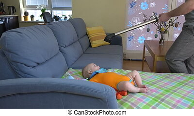 man hoover sofa baby - man father hands hoover dust from...