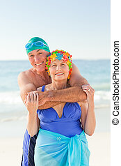 Man hugging his wife at the beach