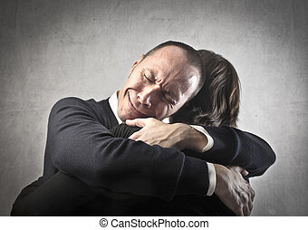 Man hugging woman